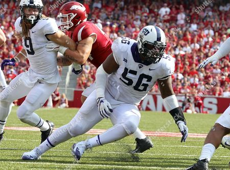 Stock Image of TCU defensive tackle Chris Bradley #56 tries to fill a hole. The TCU Horned Frogs defeated the Arkansas Razorbacks 28-7 at Donald W. Reynolds Stadium in Fayetteville, AR, Richey Miller/CSM