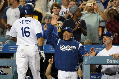 Dave Roberts, Andre Ethier. Los Angeles Dodgers manager Dave Roberts greets Andre Ethier (16) after Ethier slugged a solo home run in fifth inning of a baseball game against the Colorado Rockies, in Los Angeles