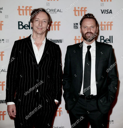 "Volker Bertelmann, Dustin O'Halloran. Composers Volker Bertelmann, left, and Dustin O'Halloran attend the premiere of ""The Current War"" on day 3 of the Toronto International Film Festival at the Princess Of Wales Theatre, in Toronto"