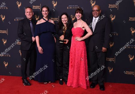 Stock Image of Jim Sommers, Lisa Tawil, Sally Jo Fifer, Lois Vossen, Garry Denny. Jim Sommers, from left, Lisa Tawil, Sally Jo Fifer, Lois Vossen, and Garry Denny pose in the press room with the governors award during night one of the Creative Arts Emmy Awards at the Microsoft Theater, in Los Angeles