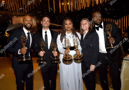 """Common, Spencer Averick, Ava DuVernay, Cindy Holland, Robert Glasper. Common, from left, Spencer Averick, Ava DuVernay, and Robert Glasper, from right, winners of the awards for outstanding original music and lyrics, outstanding documentary or nonfiction special, and for outstanding writing for nonfiction program for """"13th,"""" pose with Cindy Holland at the Governors Ball during night one of the Creative Arts Emmy Awards at the Microsoft Theater, in Los Angeles"""