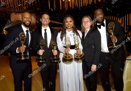 "Common, Spencer Averick, Ava DuVernay, Cindy Holland, Robert Glasper. Common, from left, Spencer Averick, Ava DuVernay and Robert Glasper, far right, winners of the awards for outstanding original music and lyrics, outstanding documentary or nonfiction special, and for outstanding writing for nonfiction program for ""13th,"" pose with Cindy Holland at the Governors Ball during night one of the Creative Arts Emmy Awards at the Microsoft Theater, in Los Angeles"