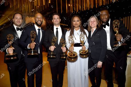 "Jason Sterman, Common, Spencer Averick, Ava DuVernay, Cindy Holland, Robert Glasper. Jason Sterman, from left, Common, Spencer Averick, Ava DuVernay and Robert Glasper, far right, winners of the awards for outstanding original music and lyrics, outstanding documentary or nonfiction special, and for outstanding writing for nonfiction program for ""13th,"" pose with Cindy Holland, second right, at the Governors Ball during night one of the Creative Arts Emmy Awards at the Microsoft Theater, in Los Angeles"