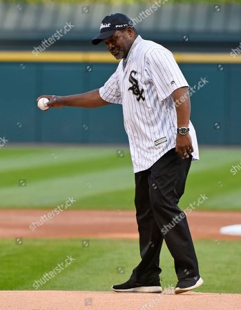 Stock Photo of Hall of Famer and former Chicago White Sox player Tim Raines throws out a ceremonial first pitch before the baseball game between the White Sox and the San Francisco Giants in Chicago on