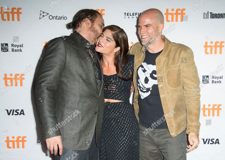 """Nicolas Cage, Selma Blair, Brian Taylor. From left, actors Nicolas Cage and Selma Blair and director Brian Taylor attend a premiere for """"Mom and Dad"""" on day 3 of the Toronto International Film Festival at the Ryerson Theatre, in Toronto"""
