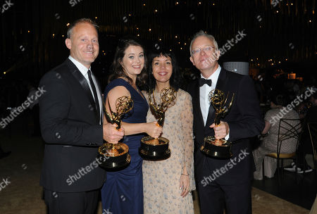 "Tom Hough-Jones, Elizabeth White, Michael Gunston, Sarah Barnett. Tom Hough-Jones, from left, Elizabeth White, and Michael Gunston, from right, winners of the award for outstanding documentary or nonfiction series for ""Planet Earth II,"" pose with Sarah Barnett at the Governors Ball during night one of the Television Academy's 2017 Creative Arts Emmy Awards at the Microsoft Theater, in Los Angeles"