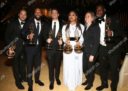 "Jason Sterman, Common, Spencer Averick, Ava DuVernay, Robert Glasper. Jason Sterman, from left, Common, Spencer Averick, Ava DuVernay and Robert Glasper, far right, winners of the awards for outstanding original music and lyrics, outstanding documentary or nonfiction special, and for outstanding writing for nonfiction program for ""13th"", pose with Cindy Holland, second right, at the Governors Ball during night one of the Television Academy's 2017 Creative Arts Emmy Awards at the Microsoft Theater, in Los Angeles"