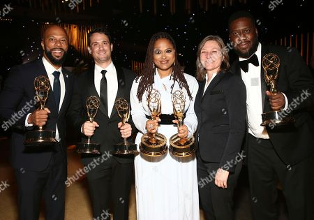 "Common, Spencer Averick, Ava DuVernay, Robert Glasper, Cindy Holland. Common, from left, Spencer Averick, Ava DuVernay and Robert Glasper, far right, winners of the awards for outstanding original music and lyrics, outstanding documentary or nonfiction special, and for outstanding writing for nonfiction program for ""13th,"" pose with Cindy Holland at the Governors Ball during night one of the Television Academy's 2017 Creative Arts Emmy Awards at the Microsoft Theater, in Los Angeles"