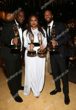 "Robert Glasper, Ava DuVernay, Common. Robert Glasper, from left, Ava DuVernay, and Common, winners of the awards for outstanding original music and lyrics, outstanding documentary or nonfiction special, and for outstanding writing for nonfiction program for ""13th"", pose at the Governors Ball during night one of the Television Academy's 2017 Creative Arts Emmy Awards at the Microsoft Theater, in Los Angeles"
