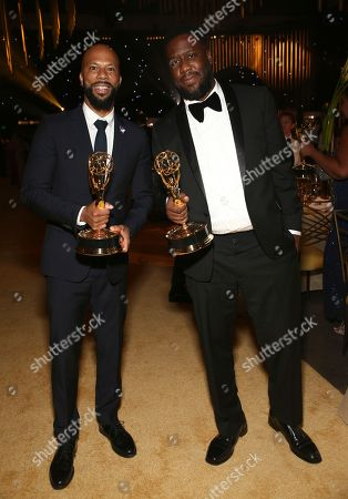 """Common, Robert Glasper. Common, left, and Robert Glasper hold their award for outstanding original music and lyrics for """"13th"""" at the Governors Ball during night one of the Television Academy's 2017 Creative Arts Emmy Awards at the Microsoft Theater, in Los Angeles"""
