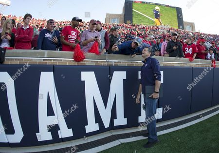 ESPN personality Mike Golic stops to take a photo with Georgia fans prior to NCAA football game action between the Georgia Bulldogs and the Notre Dame Fighting Irish at Notre Dame Stadium in South Bend, Indiana. Georgia defeated Notre Dame 20-19