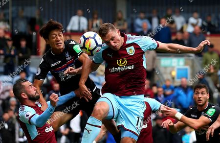 Chris Wood of Burnley challenges Lee Chung-Yong of Crystal Palace to a header