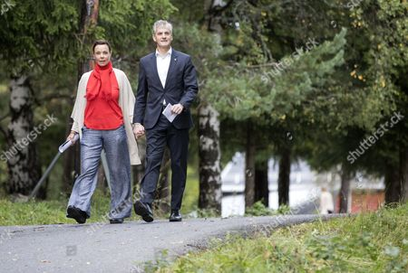 Norway's Labour Party leader Jonas Gahr Store (R) and his wife Marit Slagsvold (L) arrive at a polling station to cast their votes in the Norwegian parliamentary election in Oslo, Norway, 10 September 2017.