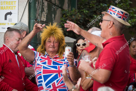 """People take part at the National Day celebrations at the British territory of Gibraltar on . The chief minister of Gibraltar says the British territory's post-Brexit future rests on strengthening its ties with the United Kingdom. Chief Minister Fabian Picardo tells The Associated Press that his goal after Britain leaves the European Union is to """"cement the relationship with the United Kingdom"""" in terms of both sovereignty and a commercial relationship"""