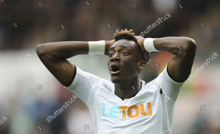 Tammy Abraham of Swansea City reacts after he beats Newcastle United goalkeeper Rob Elliot but fails to put the ball into the net