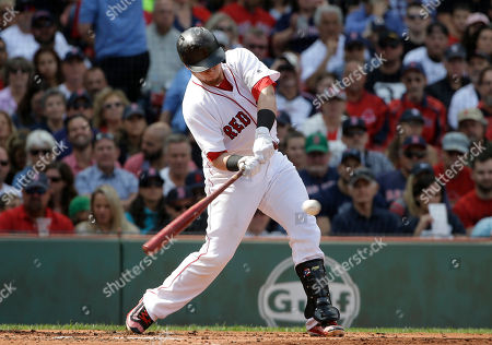Boston Red Sox's Christian Vazquez hits an RBI-single off Tampa Bay Rays' Alex Cobb in the second inning of a baseball game, in Boston. Vazquez advanced to third base on an error by Rays' Lucas Duda