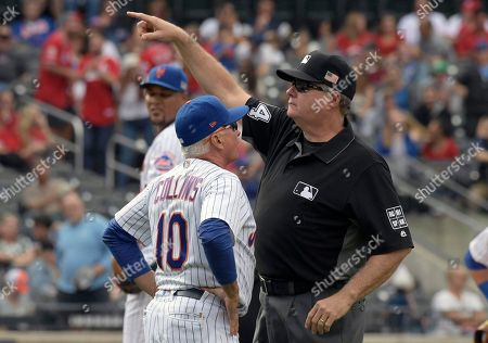 Terry Collins, Jerry Layne. Umpire Jerry Layne, right, ejects New York Mets manager Terry Collins (10) from a baseball game during the eighth inning against the Cincinnati Reds, in New York