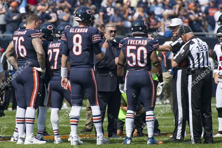 Chicago, Illinois, U.S. - Former Chicago Bears Head Coach Mike Ditka (center) during the coin flip before the NFL Game between the Atlanta Falcons and Chicago Bears at Soldier Field in Chicago, IL