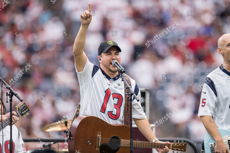 Mike Eli of the Eli Young Band performs during halftime of an NFL football game between the Houston Texans and the Jacksonville Jaguars at NRG Stadium in Houston, TX. The Jaguars won the game 29-7