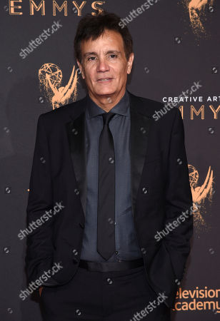 Stock Picture of Gary Lionelli arrives at night two of the Television Academy's 2017 Creative Arts Emmy Awards at the Microsoft Theater, in Los Angeles