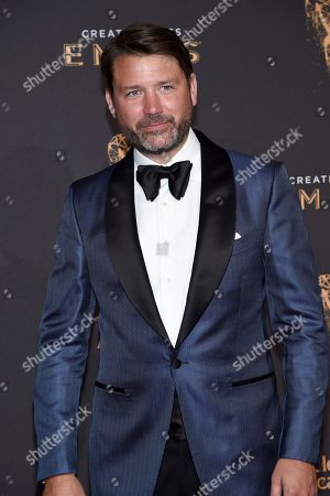 Benjamin Caron arrives at night two of the Television Academy's 2017 Creative Arts Emmy Awards at the Microsoft Theater, in Los Angeles