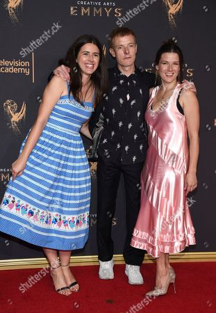 Natalie Holt, Martin Phipps, Ruth Barrett. Natalie Holt, from left, Martin Phipps, and Ruth Barrett arrive at night two of the Television Academy's 2017 Creative Arts Emmy Awards at the Microsoft Theater, in Los Angeles