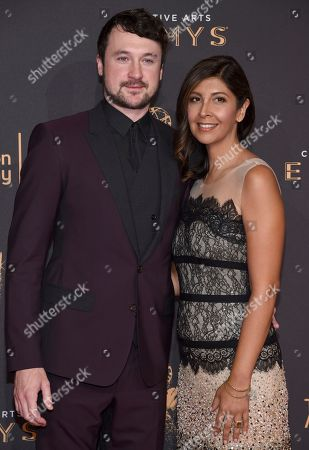 Guest, left, and Johanna Argan arrive at night two of the Television Academy's 2017 Creative Arts Emmy Awards at the Microsoft Theater, in Los Angeles