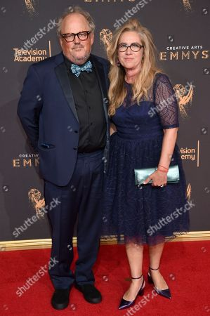 Tim Ives, left, and guest arrive at night two of the Television Academy's 2017 Creative Arts Emmy Awards at the Microsoft Theater, in Los Angeles