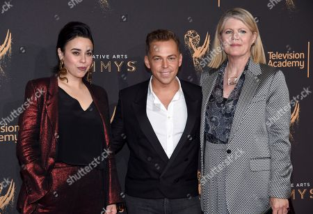 Jennifer Salim, Paolo Nieddu, Mary Lane. Jennifer Salim, from left, Paolo Nieddu, and Mary Lane arrive at night two of the Television Academy's 2017 Creative Arts Emmy Awards at the Microsoft Theater, in Los Angeles