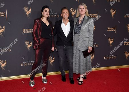 Stock Picture of Jennifer Salim, Paolo Nieddu, Mary Lane. Jennifer Salim, from left, Paolo Nieddu, and Mary Lane arrive at night two of the Television Academy's 2017 Creative Arts Emmy Awards at the Microsoft Theater, in Los Angeles