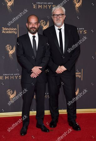 Adriano Goldman, Martin Childs. Adriano Goldman, left, and Martin Childs arrive at night two of the Television Academy's 2017 Creative Arts Emmy Awards at the Microsoft Theater, in Los Angeles