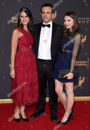 Stock Image of Emma Jacobs, Rupert Gregson-Williams, Saskia Gregson-Williams. Emma Jacobs, from left, Rupert Gregson-Williams, and Saskia Gregson-Williams arrive at night two of the Television Academy's 2017 Creative Arts Emmy Awards at the Microsoft Theater, in Los Angeles