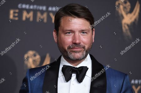 Benjamin Caron arrives at night two of the Creative Arts Emmy Awards at the Microsoft Theater, in Los Angeles