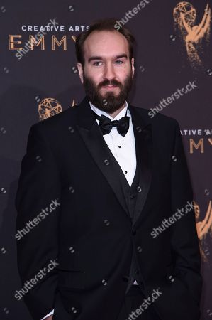 Eric Demeusy arrives at night two of the Creative Arts Emmy Awards at the Microsoft Theater, in Los Angeles