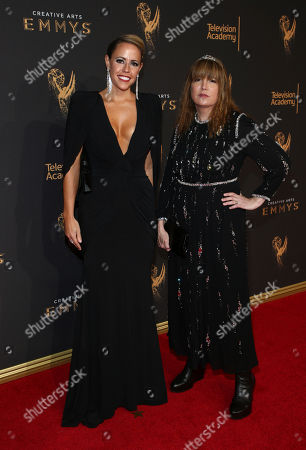 Stock Image of Jamie Walker McCall, Judy Becker. Jamie Walker McCall, left, and Judy Becker arrives at night two of the Television Academy's 2017 Creative Arts Emmy Awards at the Microsoft Theater, in Los Angeles