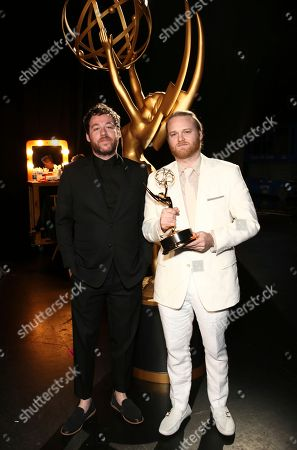 """Kyle Dixon, Michael Stein. Kyle Dixon, left, and Michael Stein, winners of the award for award for outstanding original main title theme music for """"Stranger Things"""" attend night two of the Television Academy's 2017 Creative Arts Emmy Awards at the Microsoft Theater, in Los Angeles"""