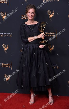 """Susan Jacobs poses in the press room with the award for outstanding music supervision for """"Big Little Lies"""" during night two of the Creative Arts Emmy Awards at the Microsoft Theater, in Los Angeles"""