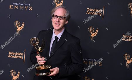 """Jeff Beal poses in the press room with the award for outstanding music composition for a series (original dramatic score) for """"House of Cards"""" during night two of the Creative Arts Emmy Awards at the Microsoft Theater, in Los Angeles"""