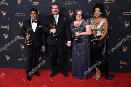"""Ralph Michael Abalos, Chris Clark, Wendy Southard, Helena Cepeda. Ralph Michael Abalos, from left, Chris Clark, Wendy Southard, and Helena Cepeda pose in the press room with the award for outstanding hairstyling for a limited series or movie for """"Feud: Bette and Joan"""" during night two of the Creative Arts Emmy Awards at the Microsoft Theater, in Los Angeles"""