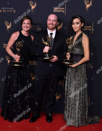 """Tara Feldstein Bennett, Chase Paris, Carmen Cuba. Tara Feldstein Bennett, from left, Chase Paris and Carmen Cuba pose in the press room with the award for outstanding casting for a drama series for """"Stranger Things"""" during night two of the Creative Arts Emmy Awards at the Microsoft Theater, in Los Angeles"""
