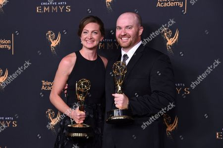 """Tara Feldstein Bennett, Chase Paris. Tara Feldstein Bennett, left, and Chase Paris pose in the press room with the award for outstanding casting for a drama series for """"Stranger Things"""" during night two of the Creative Arts Emmy Awards at the Microsoft Theater, in Los Angeles"""
