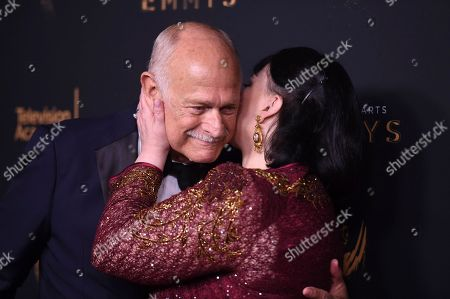 """Gerald McRaney, Delta Burke. Gerald McRaney, left, and Delta Burke pose in the press room with the award for outstanding guest actor in a drama series for """"This is Us"""" during night two of the Creative Arts Emmy Awards at the Microsoft Theater, in Los Angeles"""