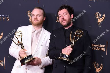 """Michael Stein, Kyle Dixon. Michael Stein, left, and Kyle Dixon pose in the press room with the award for award for outstanding original main title theme music for """"Stranger Things"""" during night two of the Creative Arts Emmy Awards at the Microsoft Theater, in Los Angeles"""