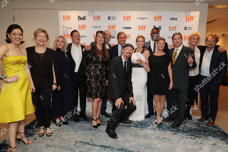 Amira Diab, Associate Producer, Mandy Walker, Cinematographer, Renee Ehrlich Kalfus, Costume Designer, David Ready, Producer, Marisa Paiva, Vice President of Fox 2000, Hany Abu-Assad, Director, Peter Chernin, Producer, Lee Percy, Editor, Kate Winslet, Idris Elba, Elizabeth Gabler, President of Fox 2000, Beau Bridges, Jenno Topping, Producer, and J. Mills Goodloe