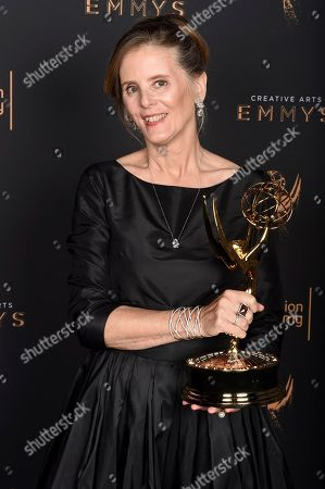 """Susan Jacobs poses for a portrait with the award for outstanding music supervision for """"Big Little Lies"""" during night two of the Television Academy's 2017 Creative Arts Emmy Awards at the Microsoft Theater, in Los Angeles"""