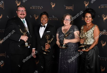 """Chris Clark, Ralph Michael Abalos, Wendy Southard, Helena Cepeda. Chris Clark, from left, Ralph Michael Abalos, Wendy Southard, and Helena Cepeda pose for a portrait with the award for outstanding hairstyling for a limited series or movie for """"FEUD: Bette and Joan"""" during night two of the Television Academy's 2017 Creative Arts Emmy Awards at the Microsoft Theater, in Los Angeles"""