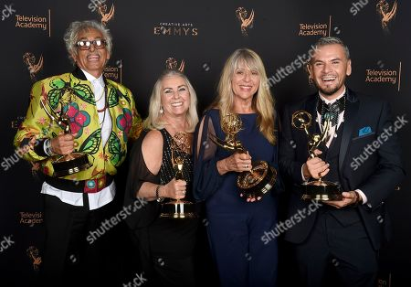 """Bruce Samia, Donna Anderson, Joy Zapata, Pavy Olivarez. Bruce Samia, from left, Donna Anderson, Joy Zapata, and Pavy Olivarez pose for a portrait with the award for outstanding hairstyling for a single-camera series for """"Westworld"""" during night two of the Television Academy's 2017 Creative Arts Emmy Awards at the Microsoft Theater, in Los Angeles"""