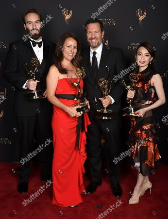 """Eric Demeusy, Michelle Dougherty, Peter Frankfurt, Arisu Kashiwagi. Eric Demeusy, from left, Michelle Dougherty, Peter Frankfurt, and Arisu Kashiwagi pose for a portrait with the award for outstanding main title design for """"Stranger Things"""" during night two of the Television Academy's 2017 Creative Arts Emmy Awards at the Microsoft Theater, in Los Angeles"""