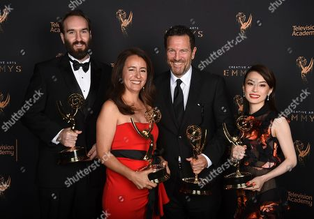 """Stock Picture of Eric Demeusy, Michelle Dougherty, Peter Frankfurt, Arisu Kashiwagi. Eric Demeusy, from left, Michelle Dougherty, Peter Frankfurt, and Arisu Kashiwagi pose for a portrait with the award for outstanding main title design for """"Stranger Things"""" during night two of the Television Academy's 2017 Creative Arts Emmy Awards at the Microsoft Theater, in Los Angeles"""