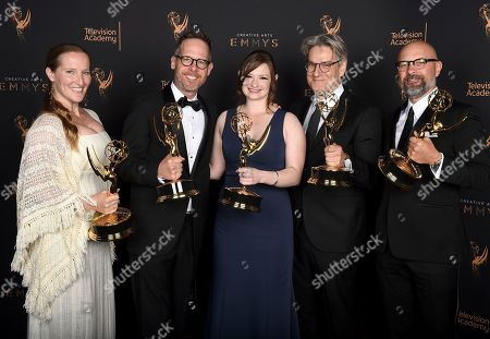 """Stock Photo of Melissa Bernstein, Dan Appel, Ariel Levine, Peter Gould, Rob Knox. Melissa Bernstein, from left, Dan Appel, Ariel Levine, Peter Gould, and Rob Knox pose for a portrait with the award for outstanding short form comedy or drama series for """"Los Pollos Hermanos Employee Training"""" during night two of the Television Academy's 2017 Creative Arts Emmy Awards at the Microsoft Theater, in Los Angeles"""